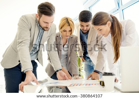 Successful team of young business people.They are working on a new project. - stock photo