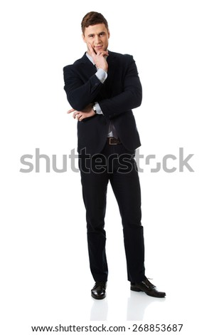 Successful thoughtful businessman with finger under chin. - stock photo