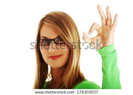 Successful woman giving perfect gesture  on white background. - stock photo