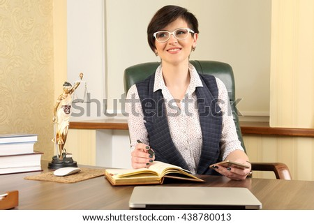 successful woman lawyer at work in the office - stock photo