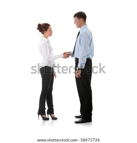 Successful young business executives shaking hands with each other - stock photo