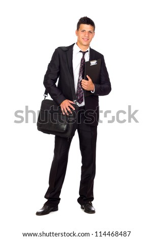 Successful young business man carrying a suitcase on white background - stock photo