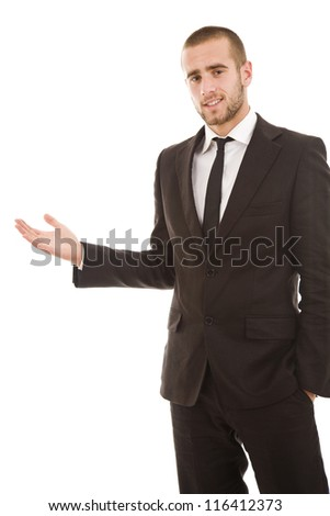 Successful young business man presenting over white background - stock photo