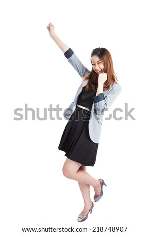 Successful young business xwoman happy for her success. Isolated full body image on white background. Mixed Asian / Caucasian businesswoman. - stock photo
