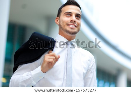Successful young businessman in the city - stock photo