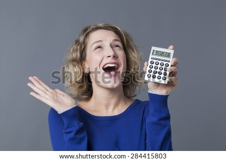 successful young woman excited at her great investments - stock photo