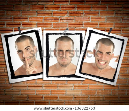 Succession of pictures posted on a brick wall of a young man mimicking see no evil, hear no evil, speak no evil - stock photo