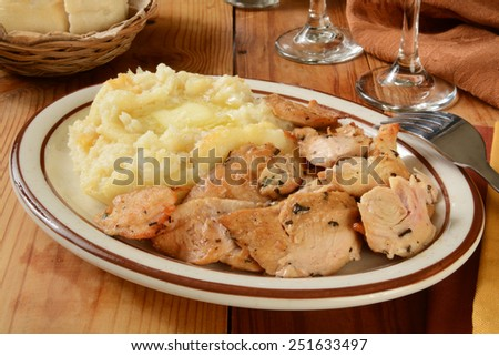 Succulent turkey morsels with mashed potatoes and butter - stock photo