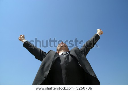 Sucess business man with arms wide open - stock photo