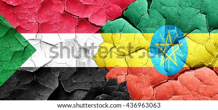 Sudan flag with Ethiopia flag on a grunge cracked wall - stock photo