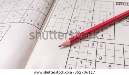 Sudoku crossword and pencil. Brain teaser logic game. - stock photo