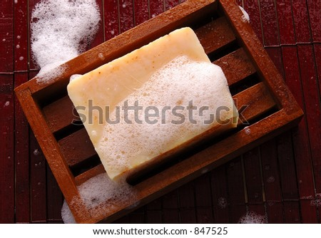 Sudsy soap in a wooden dish - stock photo