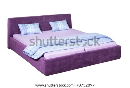 Suede double bed with striped bed linen - stock photo