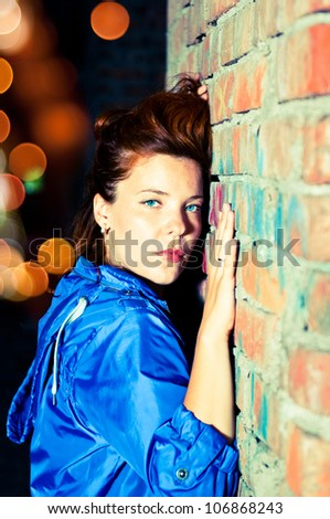 Suffering young woman on urban scenery. - stock photo