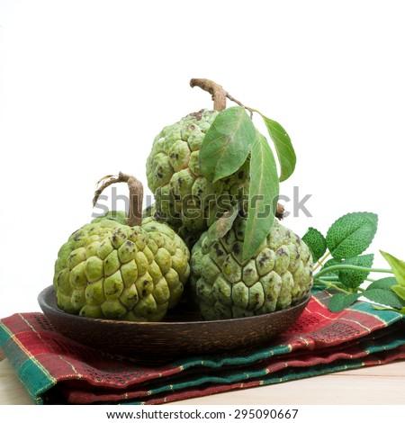 Sugar Apple (custard apple, Annona, sweetsop) on wooden table - stock photo