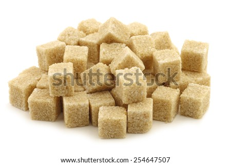sugar cane cubes on a white background - stock photo