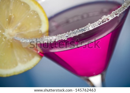 Sugar coated pink martini with lemon - stock photo