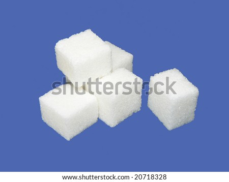 Sugar crystal on blue background - stock photo