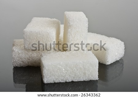 Sugar crystals on glass  background - stock photo