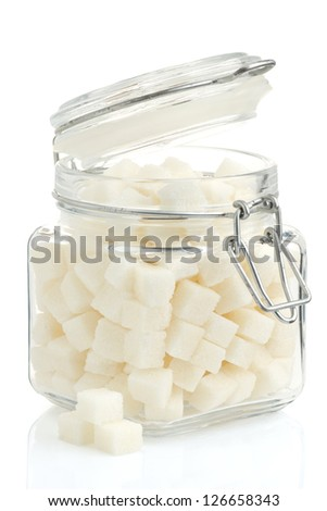 sugar cubes in pot isolated on white background - stock photo