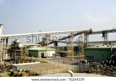 Sugar factory from Outside Conveyor Belt - stock photo