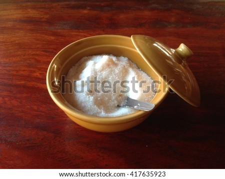 sugar Garnish for noodles In ceramic cup on a brown wooden table. Flavoring - stock photo
