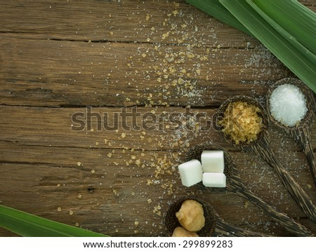 sugar in spoon on wooden background. top view - stock photo