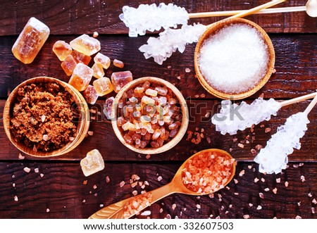 sugar in the bowl and on a table - stock photo