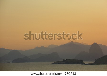Sugar loaf and Corcovado on the sunset - stock photo