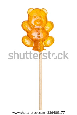 Sugar lollipop, lollypop bear on a wooden stick isolated on the white - stock photo