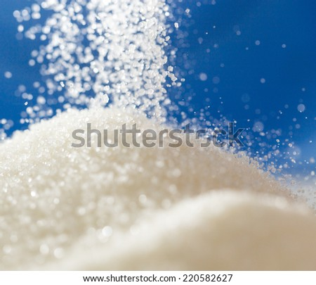 sugar on a blue background - stock photo