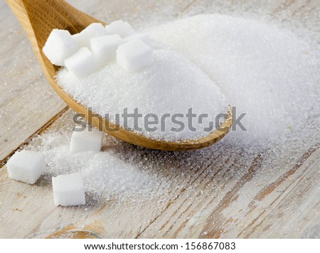 Sugar on wooden table . selective focus - stock photo