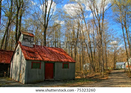 Sugar shack on a nice blue sky - stock photo