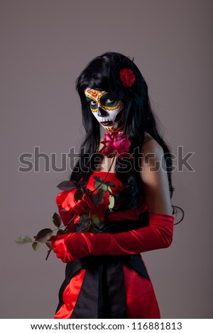 Sugar skull lady with red rose, Mexican Day of the Dead - stock photo