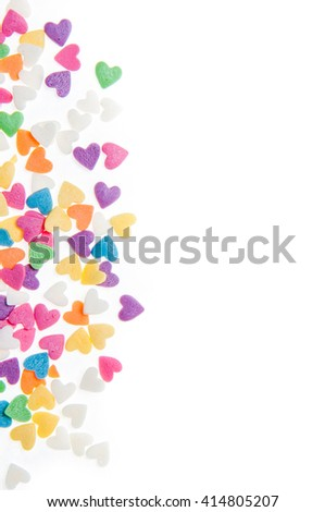Sugar sprinkle dots hearts, decoration for cake and bakery, as a background - stock photo