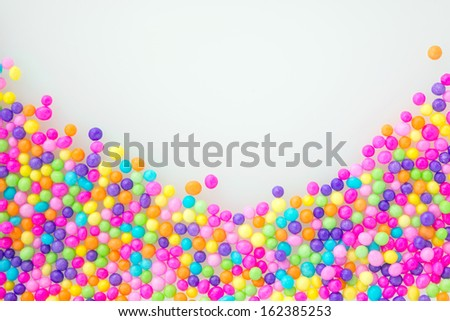 Sugar sprinkle dots, on natural white background, decoration for confectionery. High magnification macro.  - stock photo