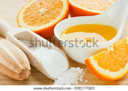 Sugar syrup with orange juice, ingredient for impregnating biscuit cake, selective focus - stock photo