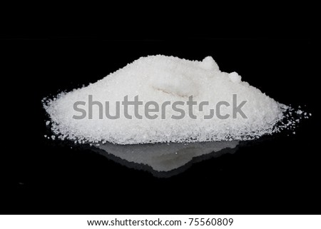Sugar white sand on a black background - stock photo