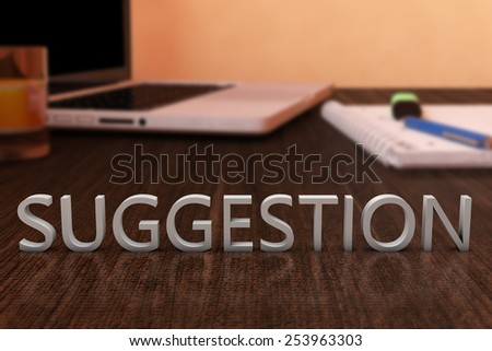 Suggestion - letters on wooden desk with laptop computer and a notebook. 3d render illustration. - stock photo