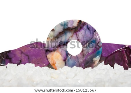 Sugilite or the Healers Stone with a polished disc for jewllery and two polished gemstones which are used in crystal healing for treating epilepsy and headaches - stock photo