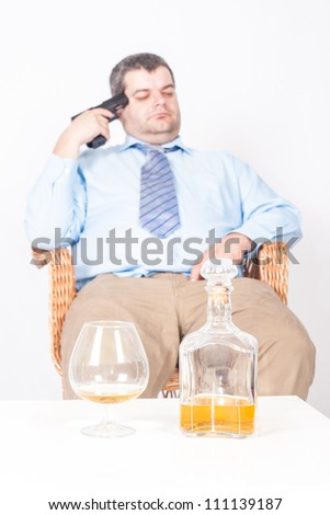 Suicide concept -  man thinking about committing suicide, white background - stock photo