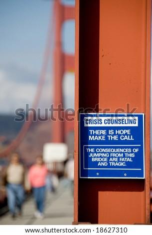 Suicide prevention notice on Golden Gate Bridge - stock photo