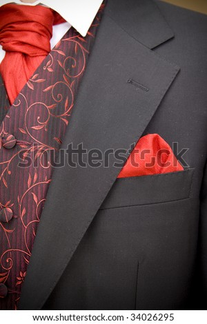 suit jacket of groom and red cravat ascot tie - stock photo