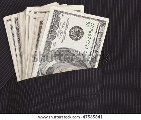 suit pocket full of 100 dollar bills - stock photo