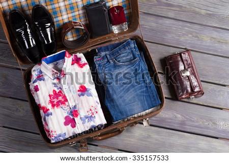 Suitcase of traveler. Macho going to the resort. - stock photo