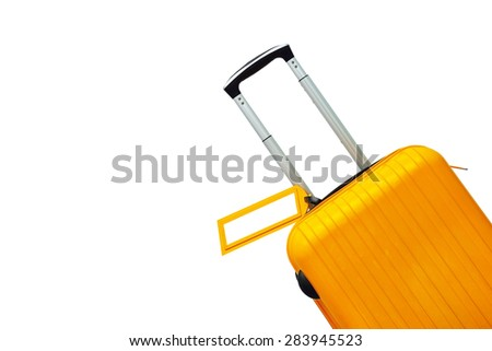 Suitcase with blank label at airport. - stock photo