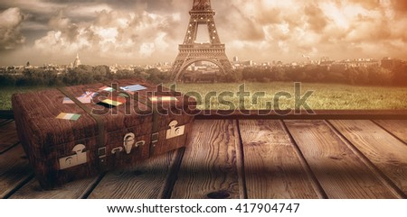 Suitcase with stickers against red curtain pulling back - stock photo