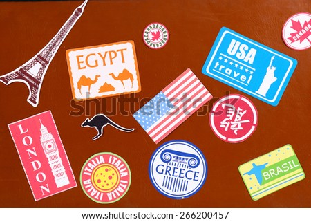 Suitcase with stickers, closeup - stock photo