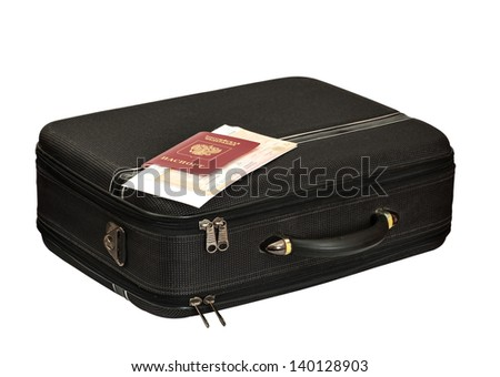 suitcase with the passport and tickets - stock photo