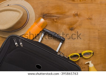 Suitcases and travel bag on a wooden background - stock photo